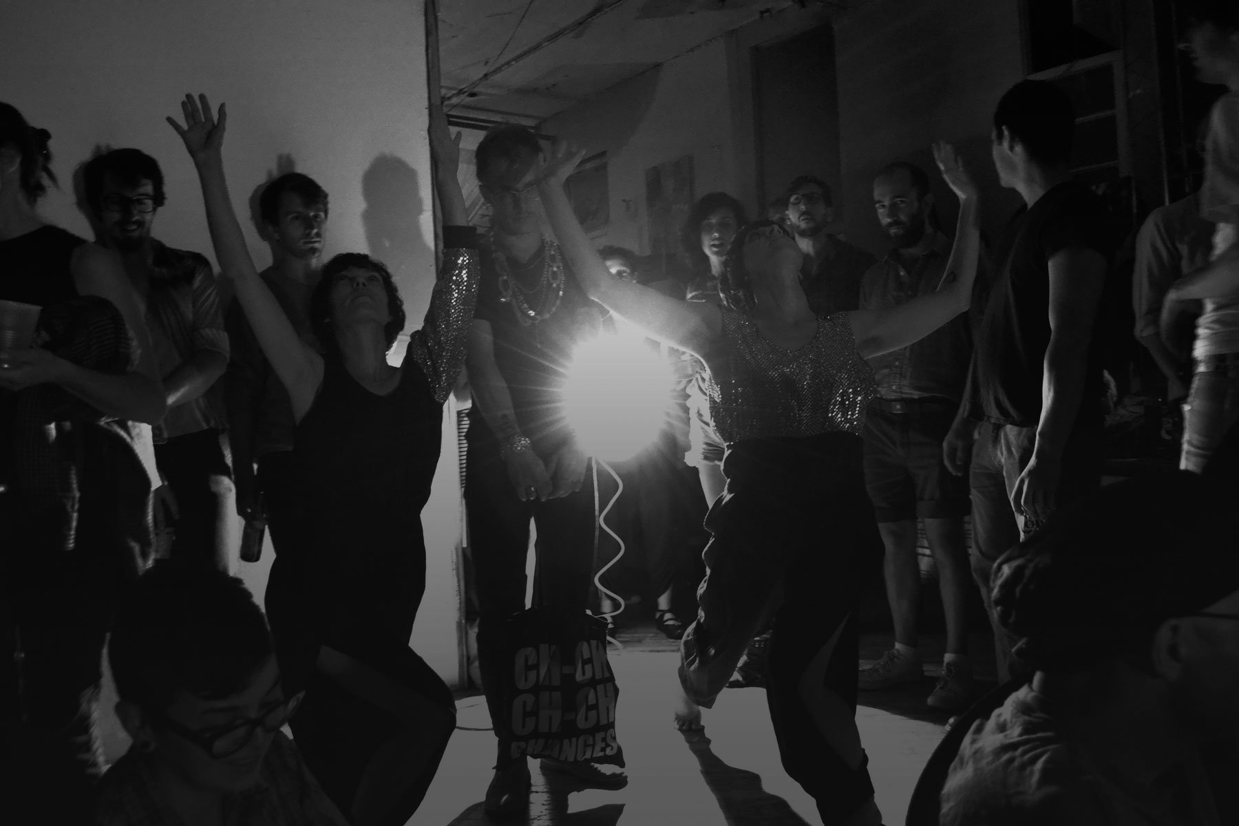 aunts is dance image in black and white people dancing in a room